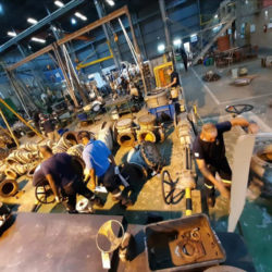 Enserve Engineering Services factory floor. with men at work. Providing valve repair services for the Oil & Gas, Petro-Chemical, Chemical, Power, Water, Mining & Minerals, Food & Beverage industries.