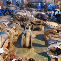 Various valve parts on the Enserve factory floor being serviced.