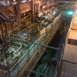 A factory floor with many valves in operation
